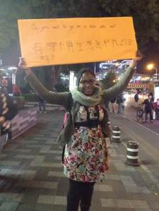 Holding up a sign to see how many Chinese men will approach me.